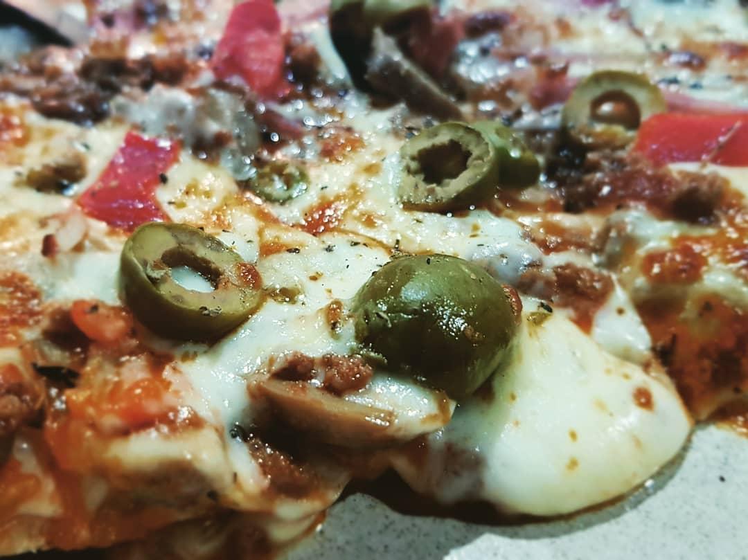 Piza à casa em Pizza Café Porto Santo